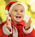 Christmas portrait of a child clapping hands royalty free stock image