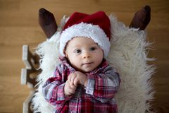 Christmas portrait of cute little newborn baby boy, dressed in c stock photos