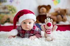 Christmas portrait of cute little newborn baby boy, dressed in c stock photo