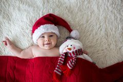 Christmas portrait of cute little newborn baby boy, wearing sant Stock Images