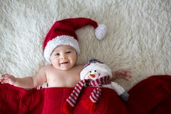 Christmas portrait of cute little newborn baby boy, wearing sant Royalty Free Stock Image