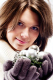 Christmas portrait of a girl. Young girl with a New Year's decorations in the hands of Stock Photography