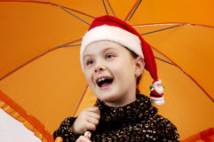 Christmas portrait of the girl 2. Christmas portrait of the girl in cap Santa Claus and with a umbrella Royalty Free Stock Image