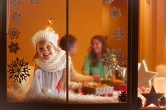 Christmas portrait of girl with binoculars Royalty Free Stock Image