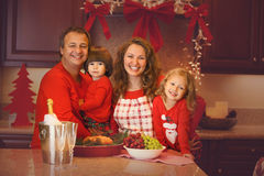 Christmas Portrait of happy family of four at home Stock Photos