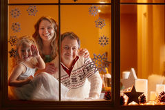 Christmas Portrait of happy family of three at home Royalty Free Stock Photography