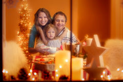 Christmas Portrait of happy family of three at home Stock Photography