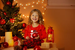 Christmas portrait of happy girl at home Stock Images