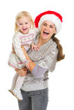 Christmas portrait of happy mom and baby Stock Image