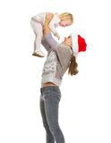 Christmas portrait of happy mother rising baby Royalty Free Stock Photos