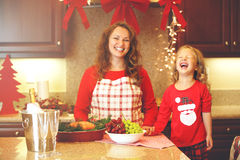 Christmas portrait of mom and daughter at kitchen Stock Image