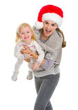 Christmas portrait of mother playing with baby Royalty Free Stock Images