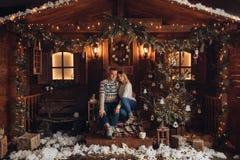 Christmas portrait of a romantic couple. beautiful house stock photo
