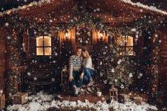 Christmas portrait of a romantic couple. beautiful house stock images
