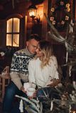 Christmas portrait of a romantic couple wooden hause stock images