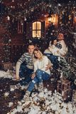 Christmas portrait of two couples. beautiful house royalty free stock photo