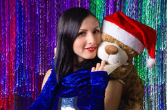 Christmas portrait woman with teddy bear Stock Photography