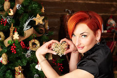 Christmas portraite of a red hair girl and her dog Royalty Free Stock Photo