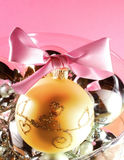Christmas postcard. Christmas decoration close-up with christmas balls on pink background royalty free stock images