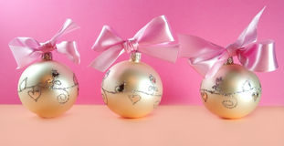 Christmas postcard. Christmas decoration close-up with christmas balls on pink background royalty free stock photos