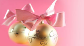 Christmas postcard. Christmas decoration close-up with christmas balls on pink background stock photo