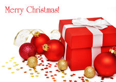 Christmas postcard. With red gift box and christmas balls over white Stock Image
