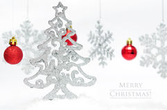 Christmas postcard. Silver style Christmas postcard with red balls over light background Stock Photos