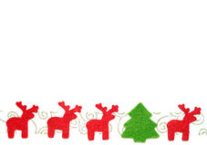 Christmas postcard. With line of red felt deers and fir-tree Royalty Free Stock Image