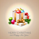 Christmas postcard, beautiful shiny baubles and gift boxes, fir branches. With snow Royalty Free Stock Photo