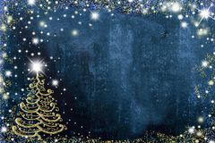 Christmas postcard copy space. Christmas postcard, freehand drawn christmas tree with golden glitter on blue background with space for text message Stock Photos
