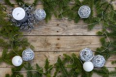 Christmas postcard frame, wooden background for greeting card. Green fir tree and silver ornaments. Garland. Xmas wallpaper royalty free stock image