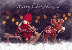 Christmas postcard. Girl on sleigh with deer Stock Photo
