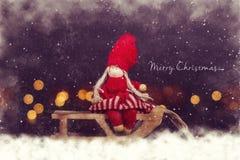 Christmas postcard. Girl on sleigh. Stock Photos