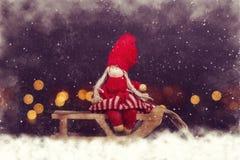 Christmas postcard. Girl on sleigh. Royalty Free Stock Photography
