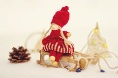 Christmas postcard. Girl on sleigh. Stock Images