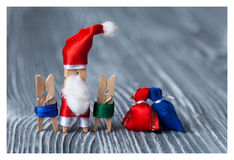Christmas postcard with kids and Santa Claus clothespin. Royalty Free Stock Photography