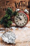 Christmas postcard. The old Soviet glass toy on the background of the clock Stock Images