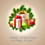 Christmas postcard, shiny baubles and gift boxes on fir branches Stock Image