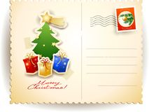 Christmas postcard with tree and gifts Stock Image