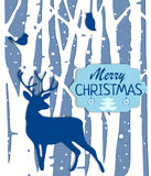 Christmas postcard with trees and deer in blue colors Royalty Free Stock Image