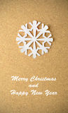 Christmas postcard with true paper snowflake Stock Image