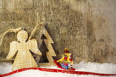 Christmas postcard. With wooden background and snow Royalty Free Stock Photos