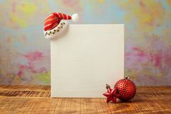 Christmas poster mock up template design with santa hat and decorations Royalty Free Stock Photos