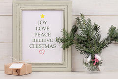 Christmas poster in  shabby chik frame,  fir branch and vintage gift box with with copy space blank tag on white background. Scand Stock Photography