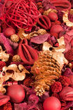 Christmas Potpourri. Background of red and golden scented Christmas potpourri royalty free stock photo