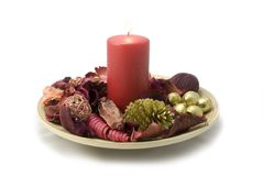 Christmas potpourri. Christmas composition with red candle and potpourri in a bowl Royalty Free Stock Photography