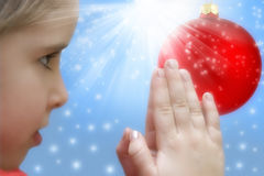 Christmas prayer. A little girl praying over Christmas background Stock Image