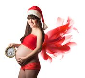 Christmas Pregnant woman with red wings. isolated Stock Photos