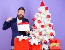 Christmas preparation and celebration. Christmas gifts and decorations. How to organize awesome office christmas party. Man bearded hipster wear formal suit stock images