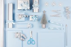 Christmas preparations background for your design and text - blank paper and silver pencil, soft pastel blue and gift boxes. royalty free stock photo